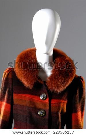 Winter fashion fur coat dress on mannequin - stock photo