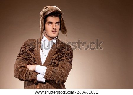 Winter fashion photo of caucasian guy with warm hat - stock photo