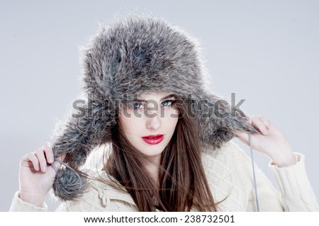 Winter fashion woman in a fur  hat. - stock photo