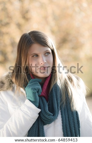 Winter fashion - woman with gloves outside, desaturated colors
