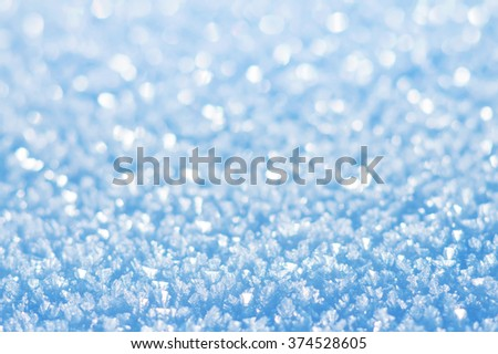 Winter festive background from brilliant bright snow