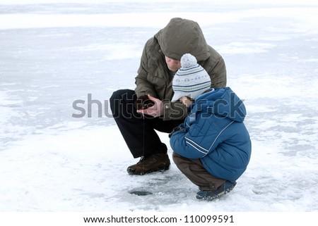 winter fishing family leisure outdoor - stock photo