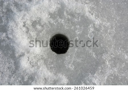Winter fishing. Ice fishing- hole in the ice  - stock photo