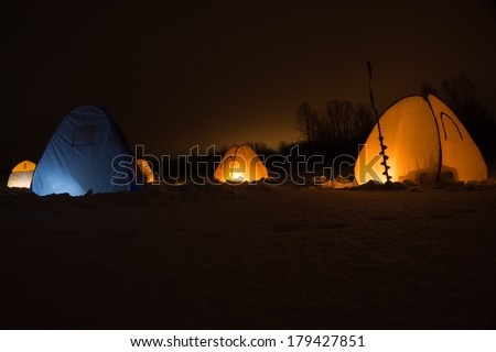 Winter fishing in the tent at night