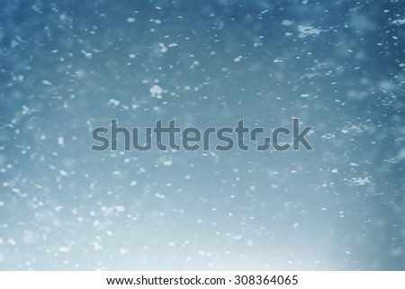 Winter flying snow in night with soft focus - stock photo