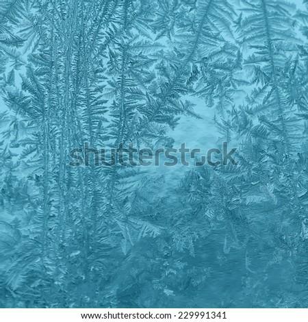 Winter frosty pattern on glass - stock photo