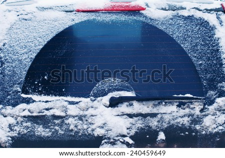 Winter frozen back car window, texture freezing ice glass background - stock photo