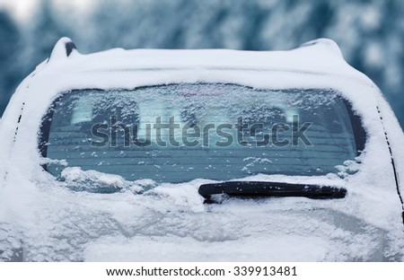 Winter frozen back car window, texture freezing ice glass background - stock photo