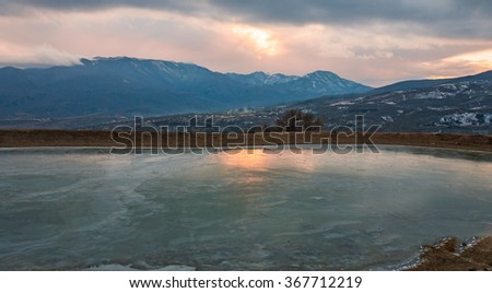 winter frozen lake at mountains