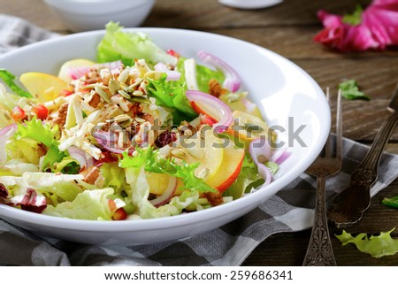 Winter fruit salad on a plate, healthy vegetarian food - stock photo