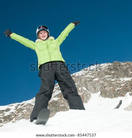 Winter fun - happy skier portrait - stock photo