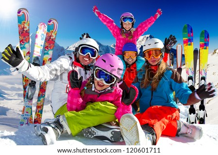 Winter fun, skiing - happy family ski team - stock photo