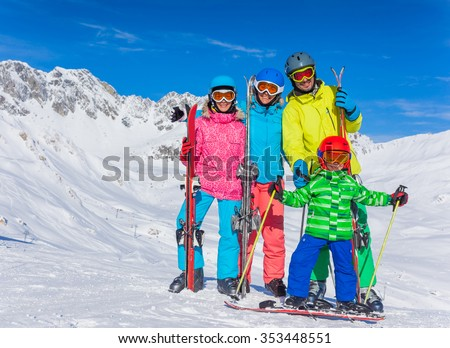 Winter fun, skiing - happy family ski team