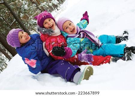 Winter fun, snow, happy children sledding at winter time  - stock photo