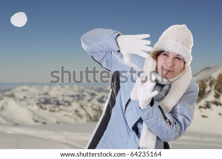 Winter fun: snowball battle against white background