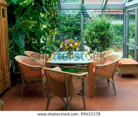 winter garden and wicker furniture - stock photo
