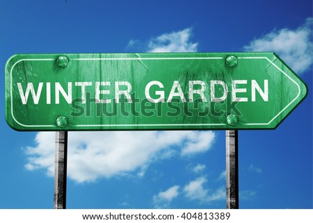 winter garden road sign , worn and damaged look