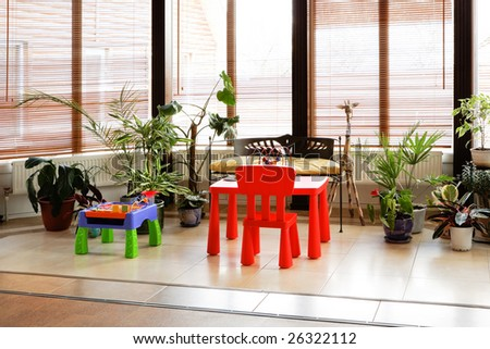 winter garden with toys and plants in the modern house - stock photo