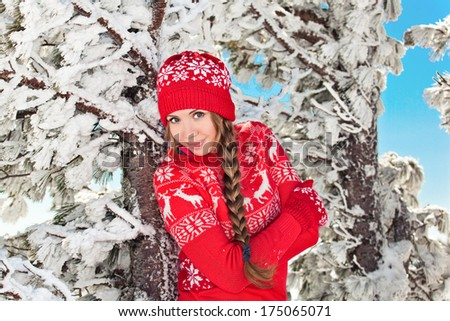 winter girl behind snow tree - stock photo