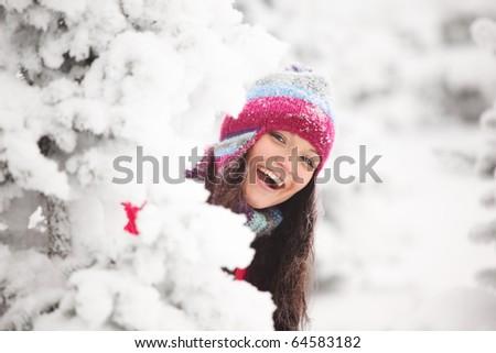 winter girl behind snow tree - stock photo