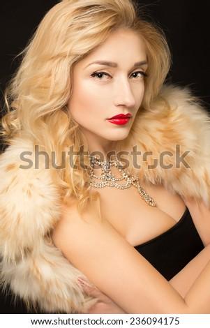 Winter Girl in Luxury Fur Coat. Fashion Fur - stock photo