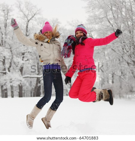 winter girl jump on snow - stock photo
