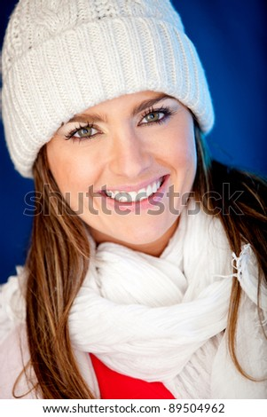 Winter girl wearing warm clothes and looking happy