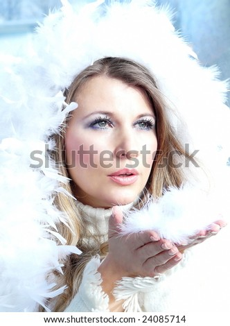 Winter Girl with beautiful make up, silver gloves and snow flake - stock photo