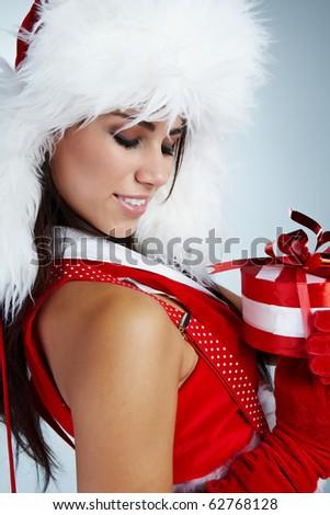 winter girl with christmas gift - stock photo