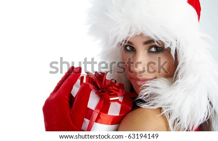 winter girl with christmas gift - stock photo