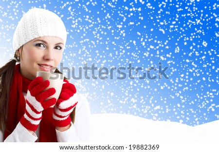 Winter Girl with cup of tea - stock photo