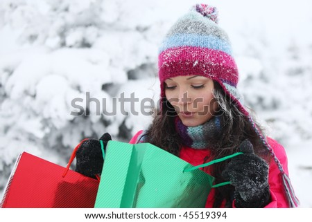 winter girl with gift - stock photo
