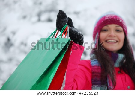 winter girl with gift bags - stock photo