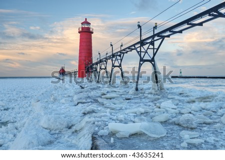 Winter, Grand Haven, Michigan Lighthouse, Lake Michigan, USA - stock photo