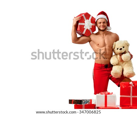 Winter happiness. Handsome Santa Claus posing shirtless in studio copyspace on the side