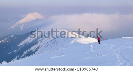 Winter - happy climber in high mountains