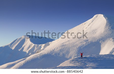 Winter - happy climber in high mountains (space for text)