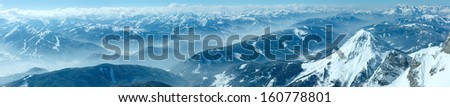 Winter hazy view from Dachstein mountain massif top to Schladming and Filzmoos region (Austria). - stock photo