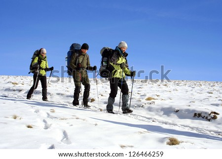 Winter hike. - stock photo
