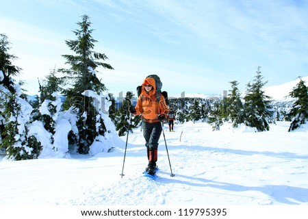 Winter hike on snowshoes. - stock photo