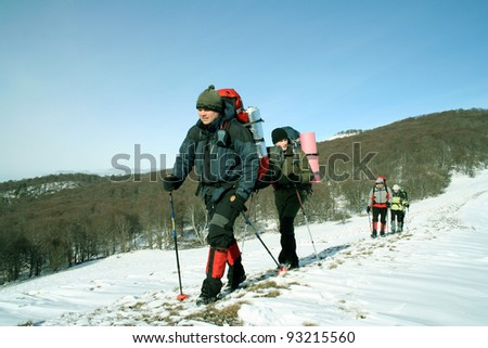 Winter hiking. - stock photo