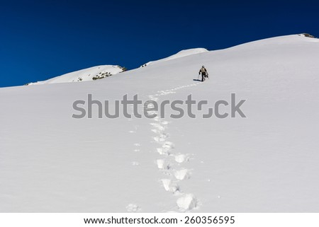 Winter hiking in the mountains  - stock photo