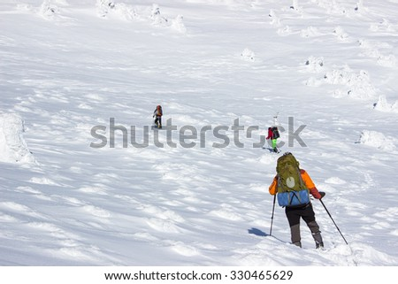 winter hiking in the mountains. - stock photo