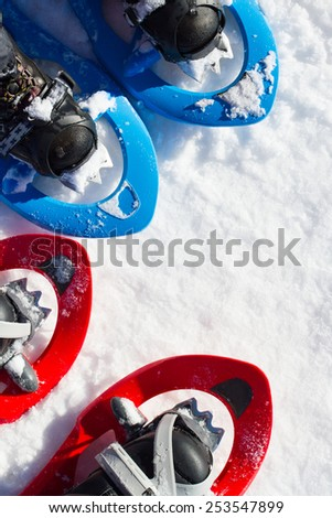 Winter hiking in the mountains on snowshoes with a backpack and tent. - stock photo