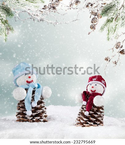 Winter holiday happy snow men with blur landscape on background - stock photo