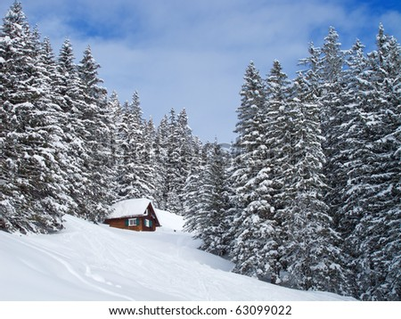 Winter holiday house in swiss alps - stock photo