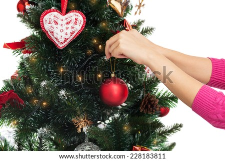 People Decorating For Christmas decorating christmas tree stock photos, royalty-free images