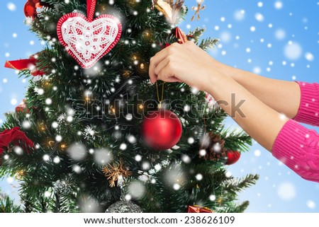 People Decorating A Christmas Tree christmas decorating hand over tree stock images, royalty-free