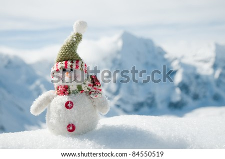 Winter Holidays - Happy snowman in mountains (space for text) - stock photo