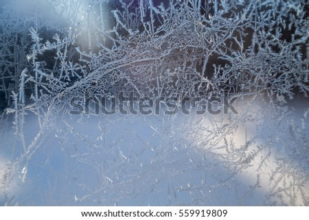 Winter ice is painted drawings on the windows - for backgrounds and textures